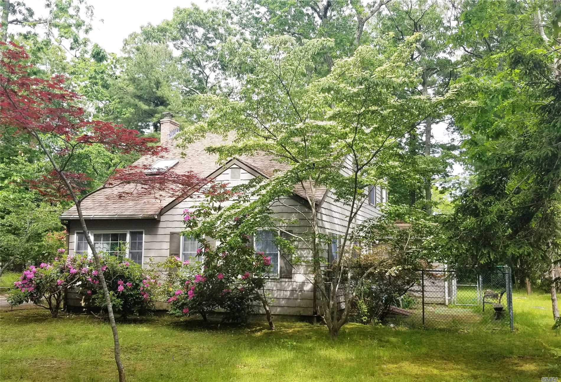 Come view this cute-as-a-button North Fork getaway, quietly tucked away in the woods near the east end of Great Hog Neck. There's a beautiful private beach for the Paradise Shores community at the end of the lane. Second floor master suite with library, formal dining room, CAC. Don't miss out!