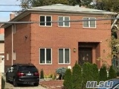 Magnificent Newly Built Brick Colonial. On Prime Location Of Forest Hills. 4 Bedrooms 3.5 Baths. Large Lr, Formal Dr, Eat In Kitchen W/Custom Cabinets And Granite Counter Tops, Large Master Br W/Cathedral Ceilings. Master Bath W/ Jacuzzi. Sky Lights, Sliding Door To Back Yard. Full Finished Basement W/3 Additional Br, Garage, Close To Express Trains, Ps 196