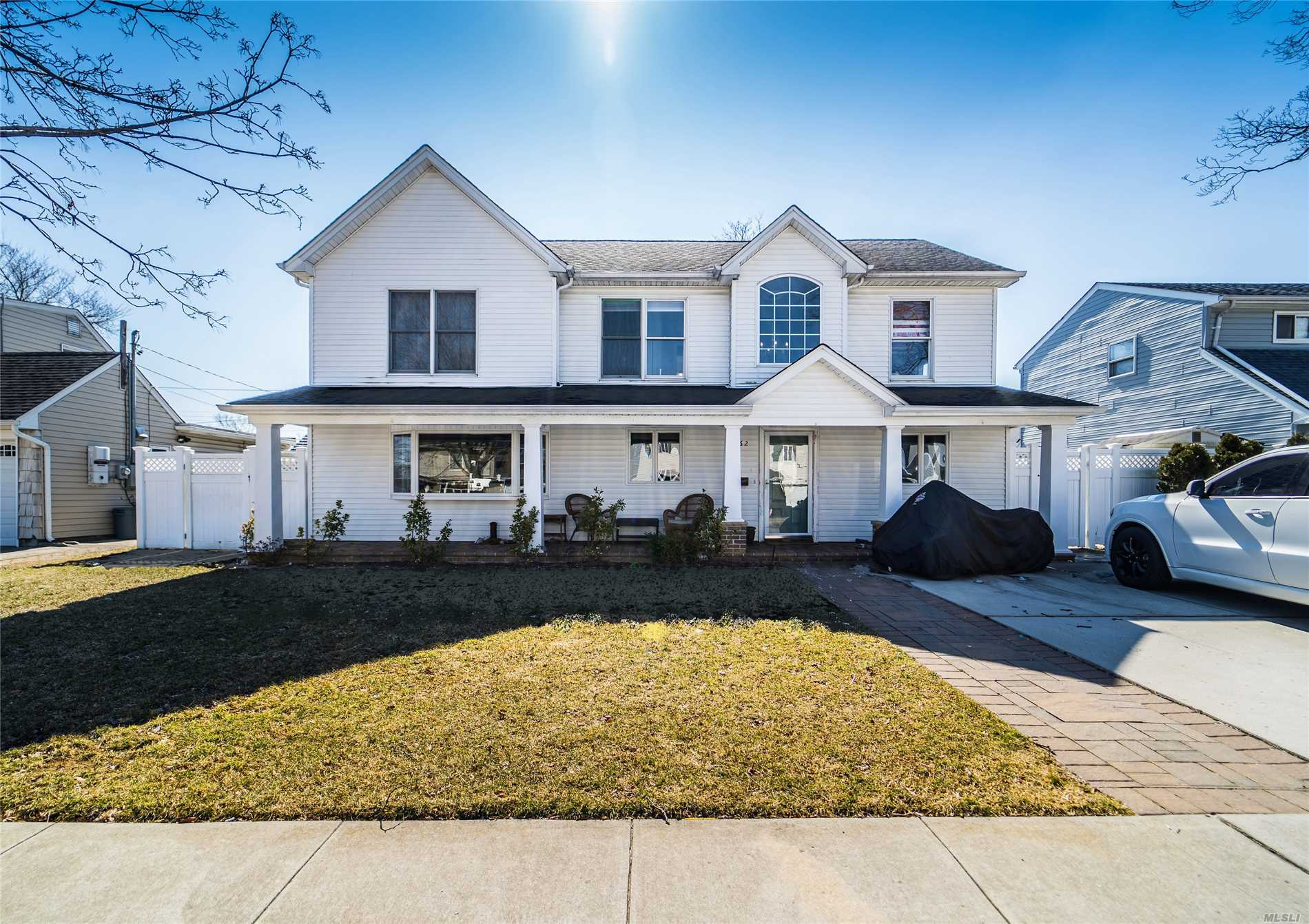 This gorgeously renovated 2226 sq ft four bedroom, three full bath colonial located in Seaford, Long Island sits on a well manicured 6000 sq ft lot and features a large front porch, radiant heat hardwood floors, crown moldings, granite counter tops, lots of windows, an abundance of closet space, a gym, cathedral ceilings, central air, a charming backyard, and much more!
