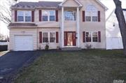Hugh 5 Bedroom, 3 full Bath Colonial. Eat in Kitchen w/Quartz Counters & S.S Appliances, Large LR w/Fpl, Fenced in Property Offering Complete Privacy During Entertaining.        One Car Garage. Full unFinished Basement, HW Flrs,  Oil Heat.