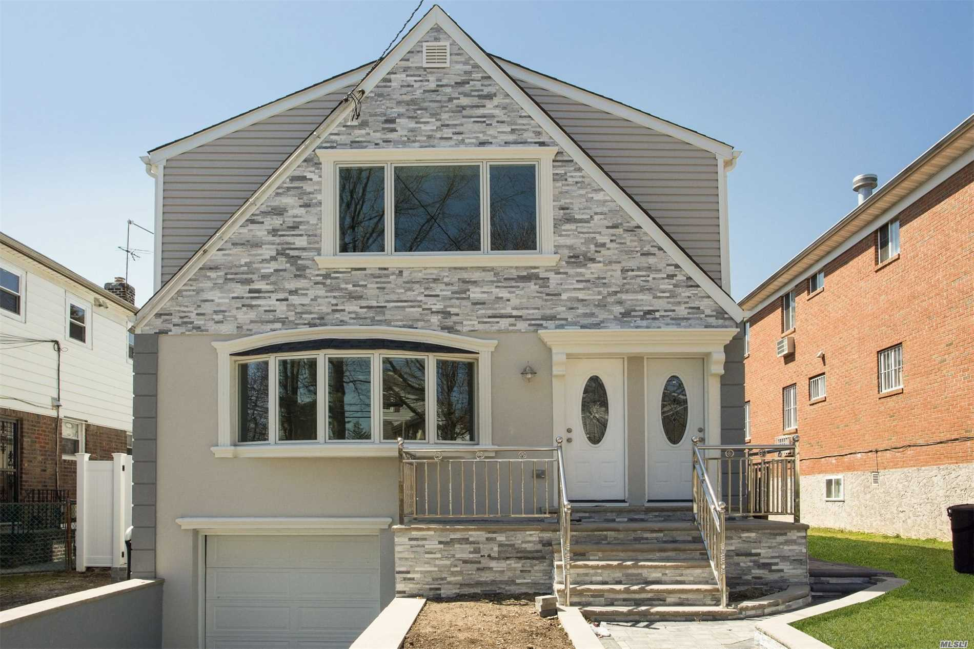 Incredible TWO Family Colonial with contemporary stucco/stone detailing, an attached garage, and unrivaled curb appeal sits on well-kept property in a desirable neighborhood. A bright entryway welcomes you to the main floor or the second floor three-bedroom unit with rich hardwood floors, impeccable molding, and designer details throughout. Entertain guests in the large and inviting living/dining room with a gorgeous bay window and a sleek kitchen is complete with new stainless steel appliances
