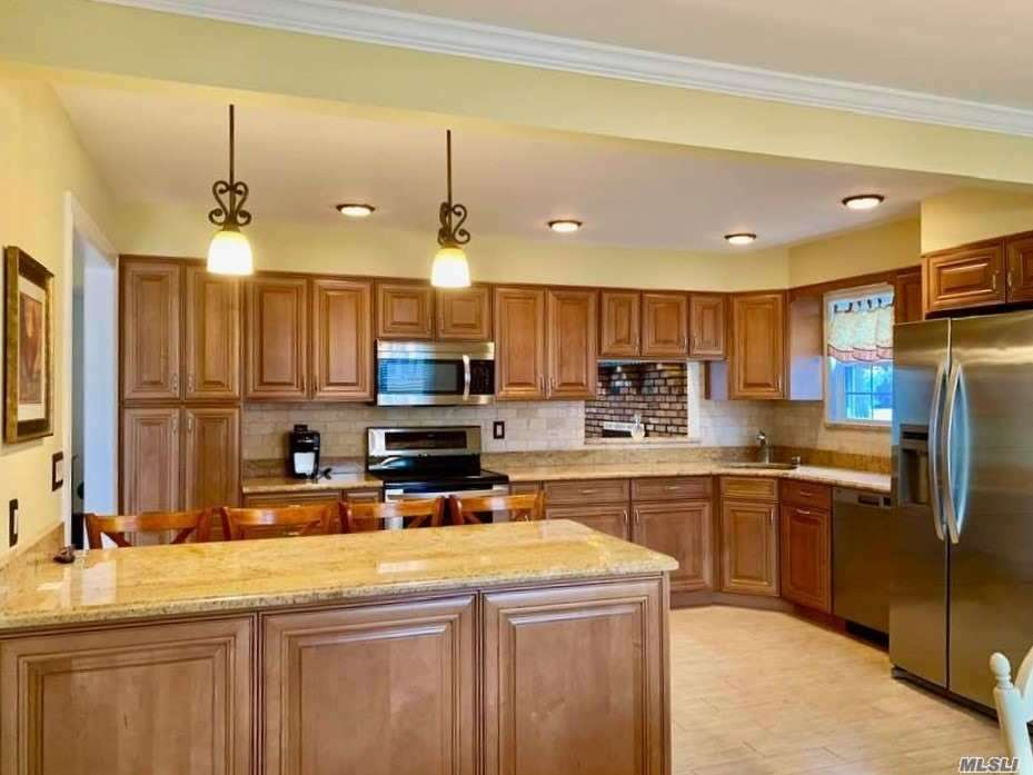 Pride of Ownership Abounds This Impeccably Renovated Spacious 4 Bedroom Splanch Featuring: Eat-In-Kitchen W/Granite Counter Tops And Stainless Steel Appliances, Living Room W/Vaulted Ceiling,  New Heating System, Roof, Anderson Windows,  Central-Air,  Wood Burning Fireplace In Den, Hardwood Floors and Porcelain Tile Throughout, Updated Bathrooms, 200 Amp Electric, Stunning Backyard Perfect for Entertaining and More. Zone AE. Located on a Quiet Mid-Block Location. Just Unpack Your Bags!!
