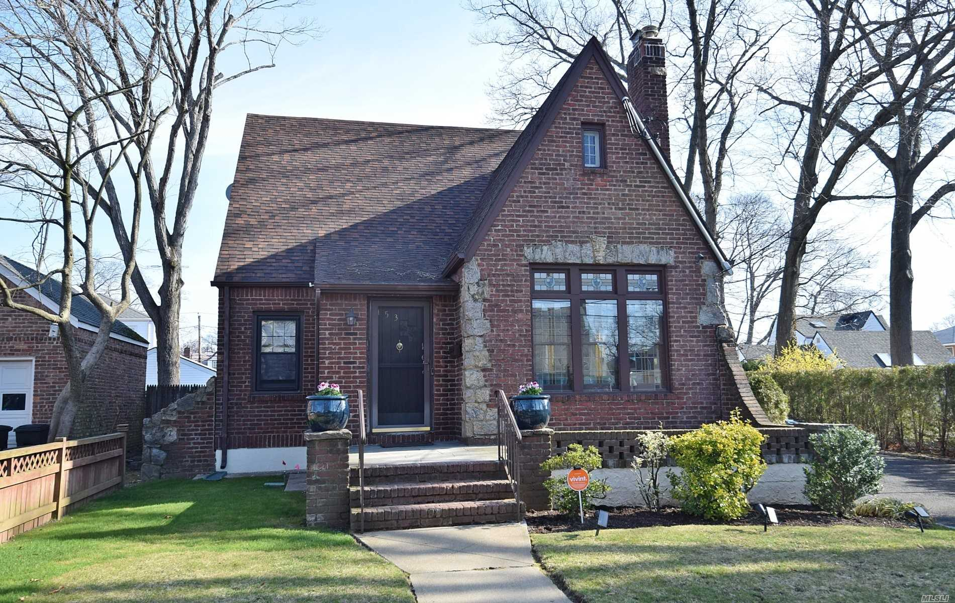 Rare Immaculate Traditional Tudor Style Brick Home in the Heart of Valley Stream, blocks off of Merrick and close to all conveniences. Come take a look at this charming property in Absolute Pristine condition. Formal Living & Dining Rooms. High ceilings, Open Concept Kitchen with Pantry, attached Den with Sliders to the Deck & Backyard. New Hardwood floors, New Bathroom, New roof, New Garage doors, Finished Basement with tons of storage and OSE. Walk-in Closet and addt'l storage on 2nd Fl.