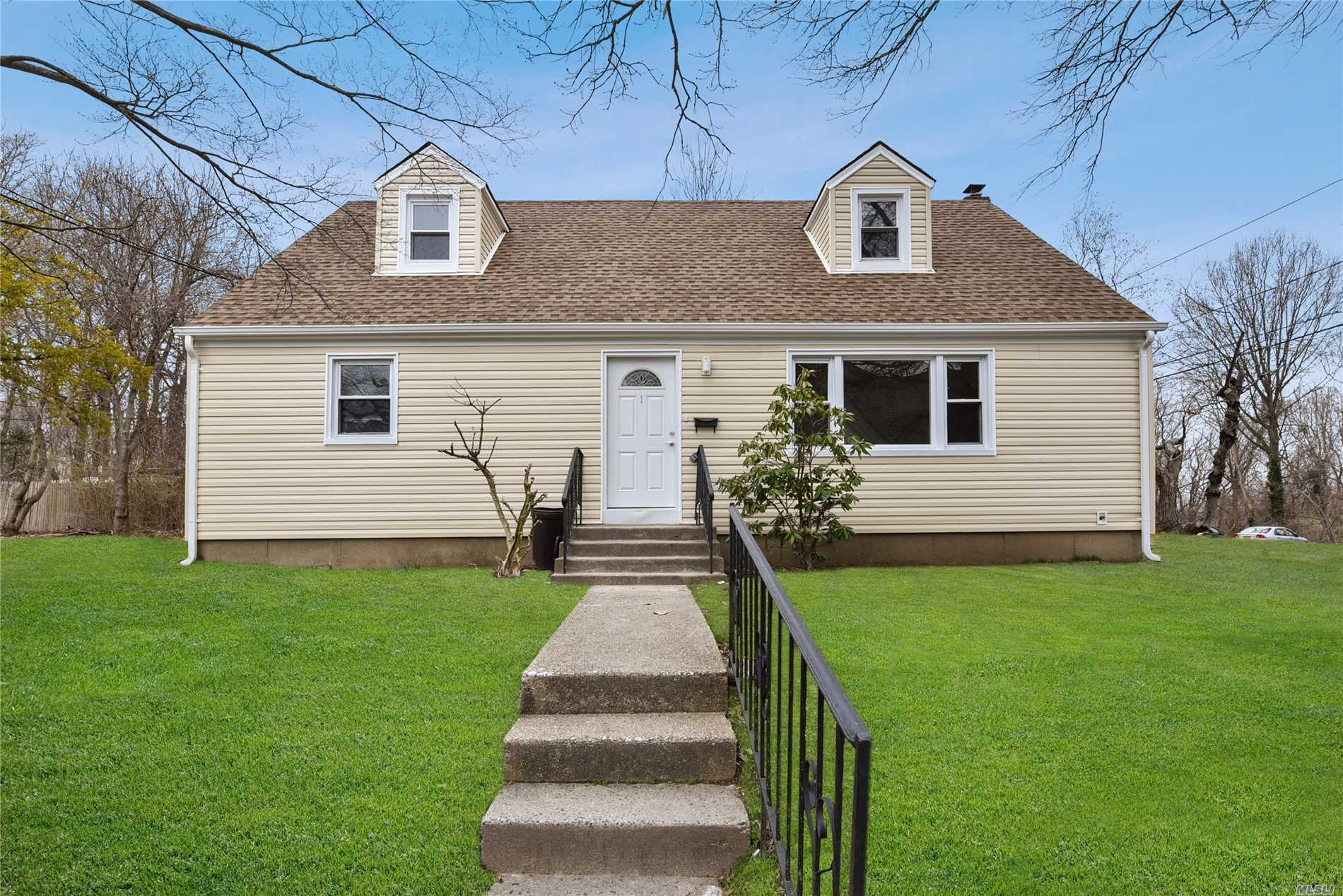 Glen Cove. Nicely Renovated Cape Home, New Kitchen with New Appliances, New Roof, New Siding, 4 Bedrooms, 3 Full Baths, Wood Floors, Tile Finished Basement with a Full Bath.