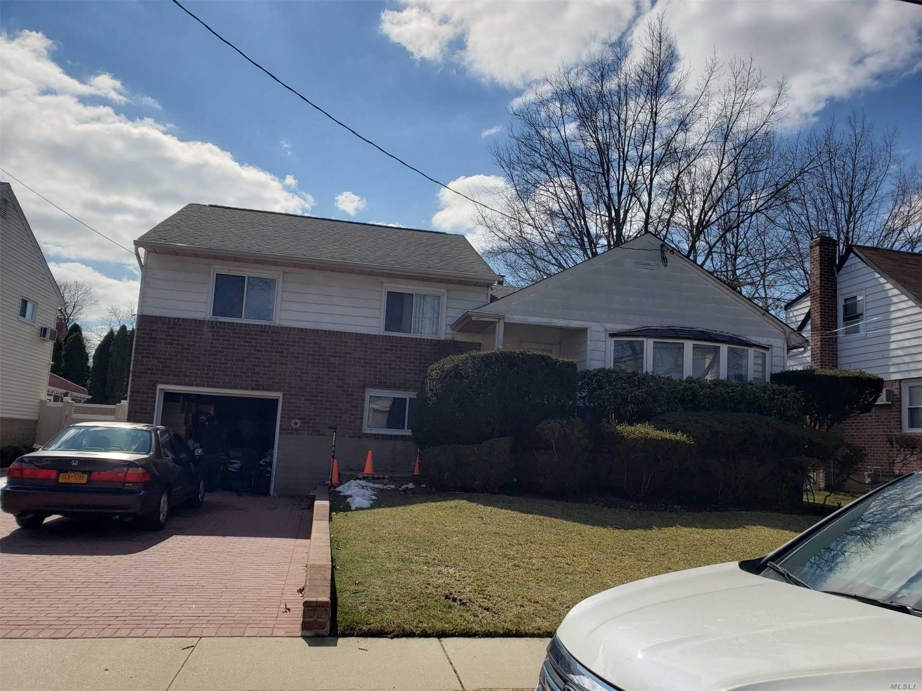 Sunny split level in a convenient location close to Southern St and Belt Pkwy. Plenty of space to entertain with large living room and separate family room. Plenty of storage throughout with finished basement. Quiet street. Large outdoor deck.