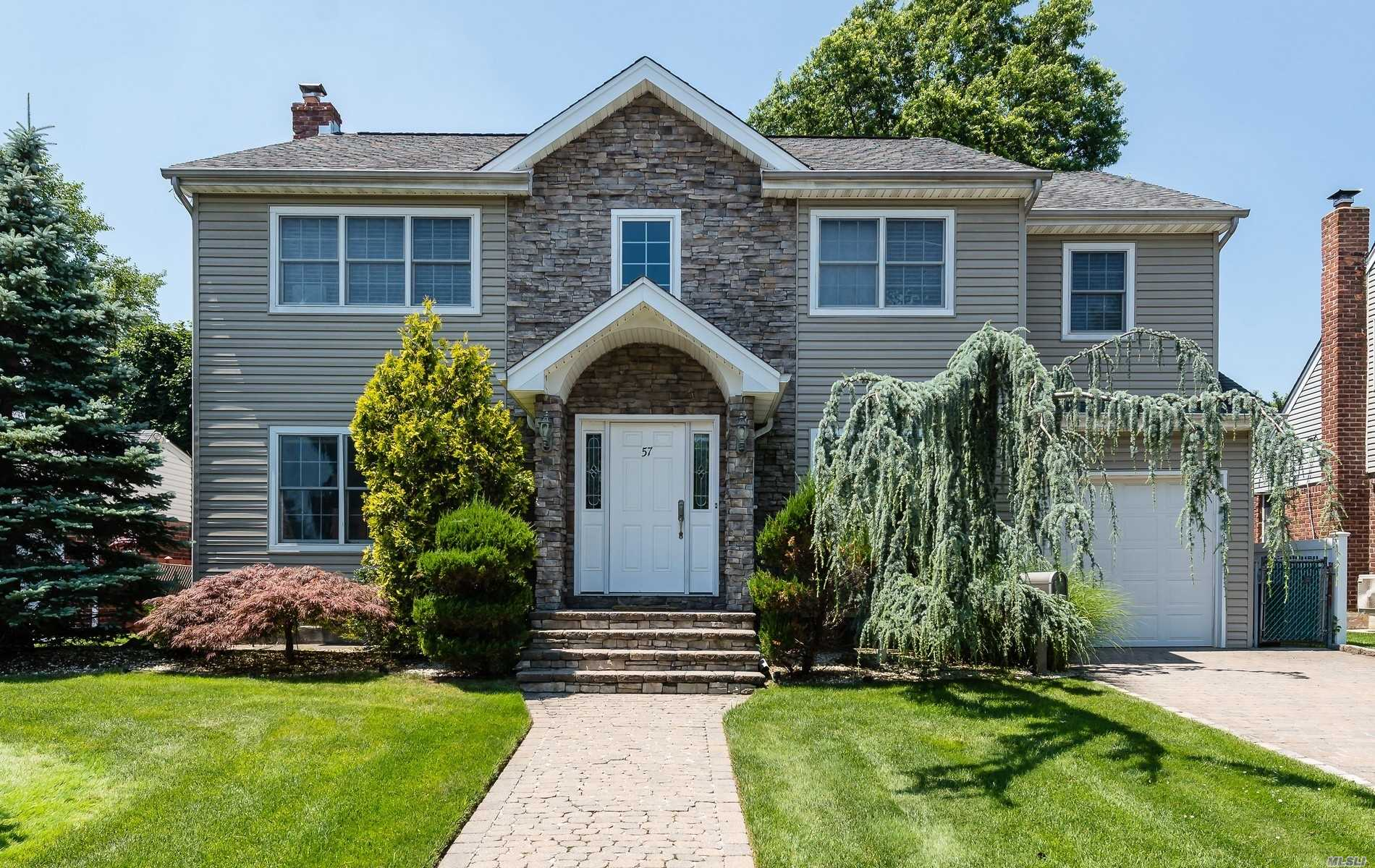 Call listing agent, Rebecca Zinn, for appointments. Move right into this completely updated 4 bedroom center hall colonial, 2 story foyer, open floor plan, hardwood floors, stainless steel appliances, large basement with office. Immaculate condition, excellent location. Herricks Schools