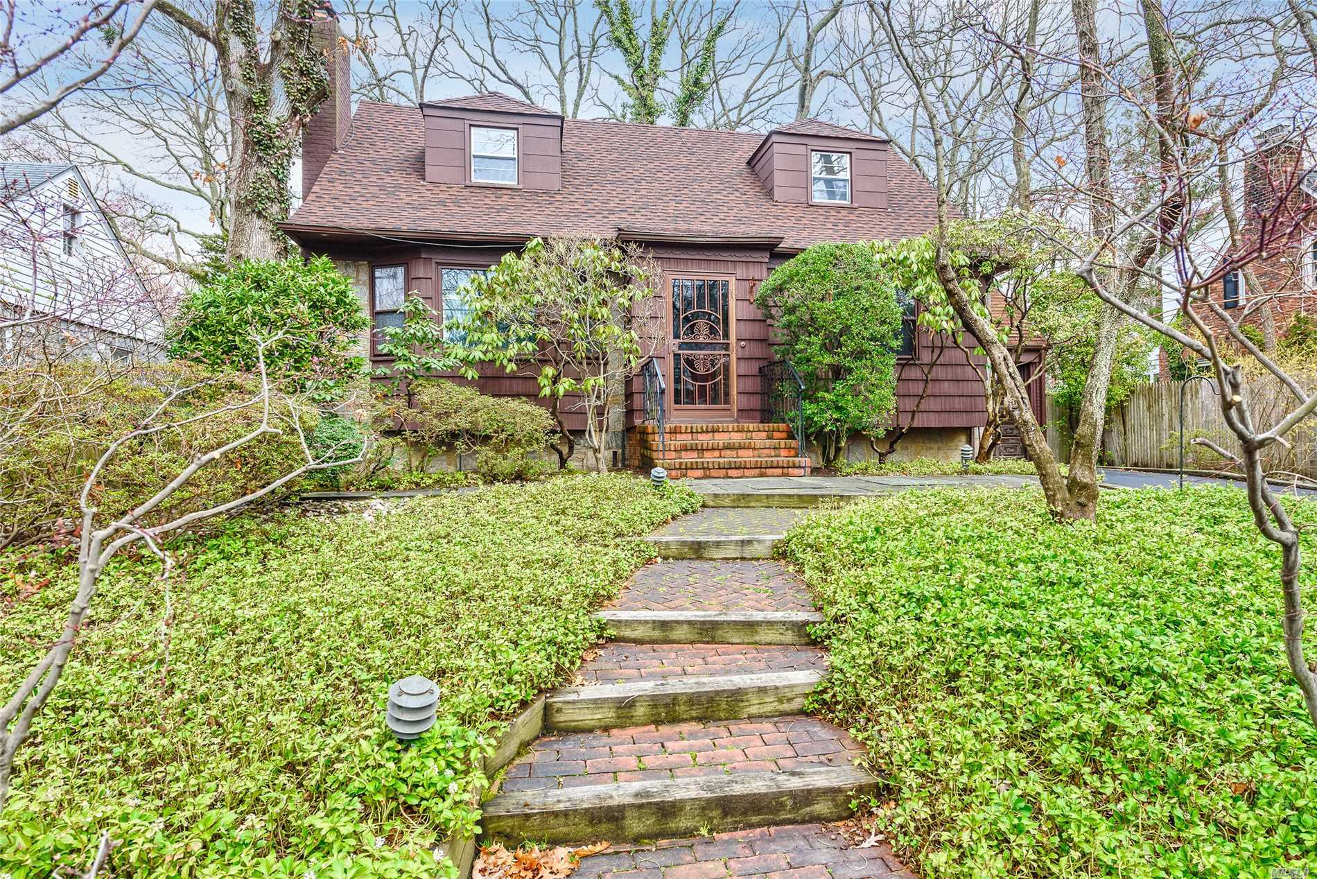 Great Expanded Cape in the heart of the woods on a quiet tree lined street. Wood Burning fireplace in Living Room. Stove in Den that leads to lovely yard. Hardwood floors thru out. Updated EIK and Master Bath. 2nd floor is a great Master suite with tons of closets, and a sitting area. French drain in basement. Make this home your own.