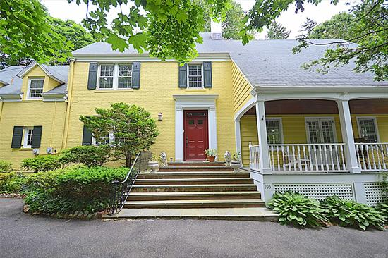 Gracious Colonial Set on 2 Acres of Private Park-Like Property. With its Vintage Charm and Modern Comfort, the Home Boasts 5 Bedrooms, 4.5 Baths, Formal Dining Room, Eat-In Kitchen, Butler's Pantry, Sun-drenched Breakfast Nook, A Bonus Room/Office/Study and Many More. North Shore School District, Close To All.