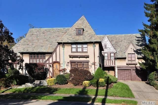 One-of-a-king English Tudor mansion in historic Jamaica Estates On A Beautiful Tree-lined Street . Breath-taking cathedral ceiling 20 Ft with Fireplace, Hard wood Floors, Custom Built library on second-floor overlooking the living room. Highest-quality huge stained-glass custom made windows unique to this home. Separate Breakfast room & Large Renovated kitchen with Granite island and restaurant-quality stove And Stainless Steel Appliances. Computer Room. 2 Separate Entrances to the second floor.