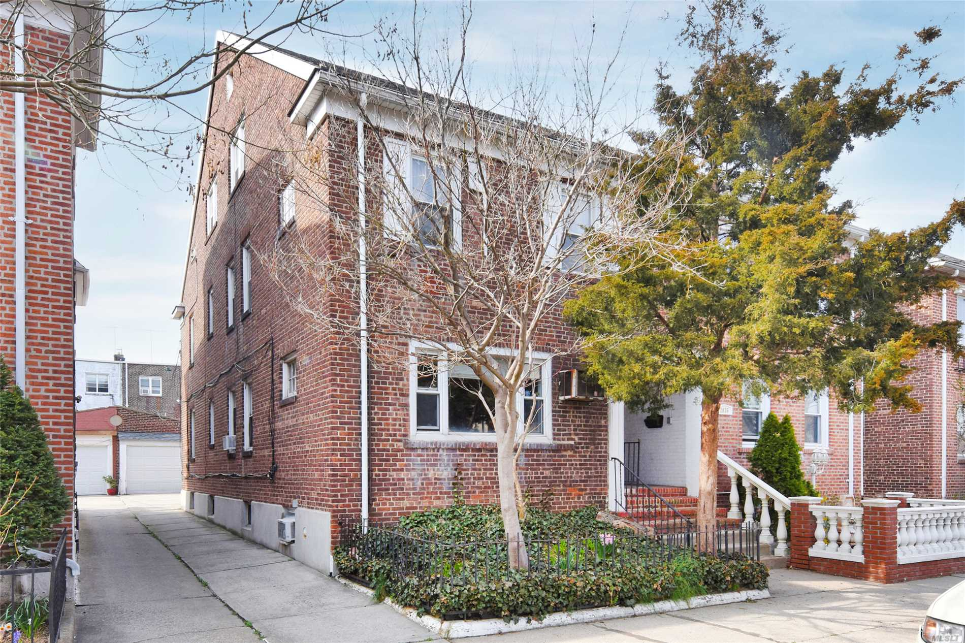 Beautiful Semi detached brick home in Ditmars!. This lovely two family has an owners duplex that includes 3 bedrooms, full bath, updated EIK w/ose, Formal Living Rm & Dining Rm & an Office. The first level hosts a lovely 2 bedroom 1 full bath apartment. Detached 2 car garage, backyard, hardwood floors, New Boiler & hot water heater. Zoned for P.S. 122. Close proximity to the Ditmars train Station, Zoned for PS 122.