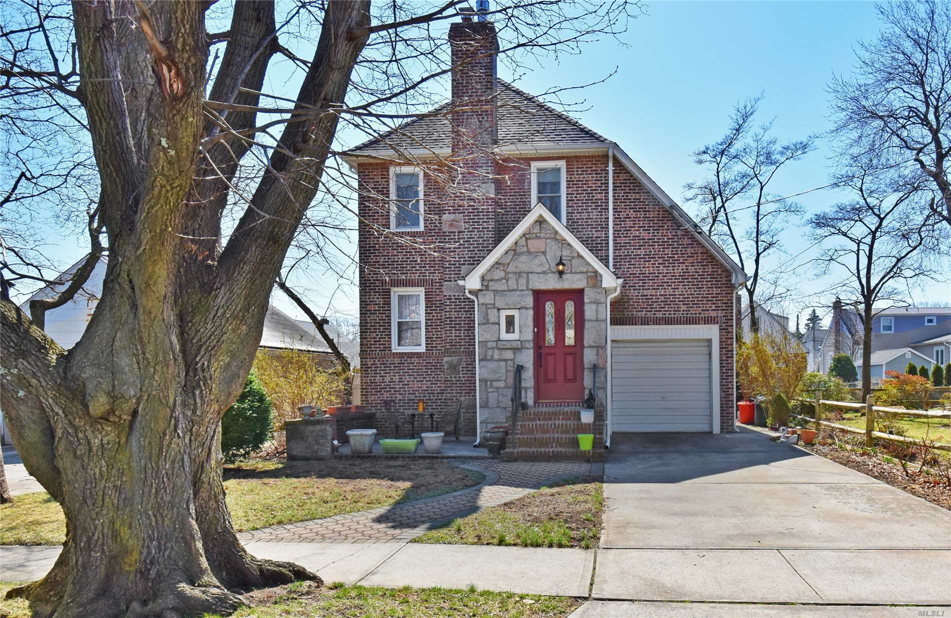 Beautiful brick colonial located in the heart of Mineola. Absolutely Move in Condition. 3 bdrm, 1fbth and 1/4 bth. Mdrm has 2 lg closets. The bath has been updated along with the kit which has granite and S/S appl's. The Lrm has stone fplc with gas insert.The stairway is stained oak and All rooms have custom moldings and custom radiator covers. All windows are updated with energy efficient double pane. The front porch has concrete patio and rear yard have lovely pavers great for entertaining.