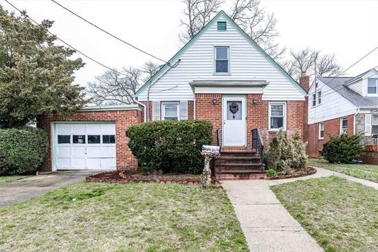 4BR cape in North Lynbrook. Full basement with high ceilings would make a great family room. 1 car garage and 2 driveways for lots of parking. New roof 1st layer 2012, gas boiler 2008, updated electric panel 2018. Close to schools, LIRR, and highways. **Taxes successfully grieved for 2020