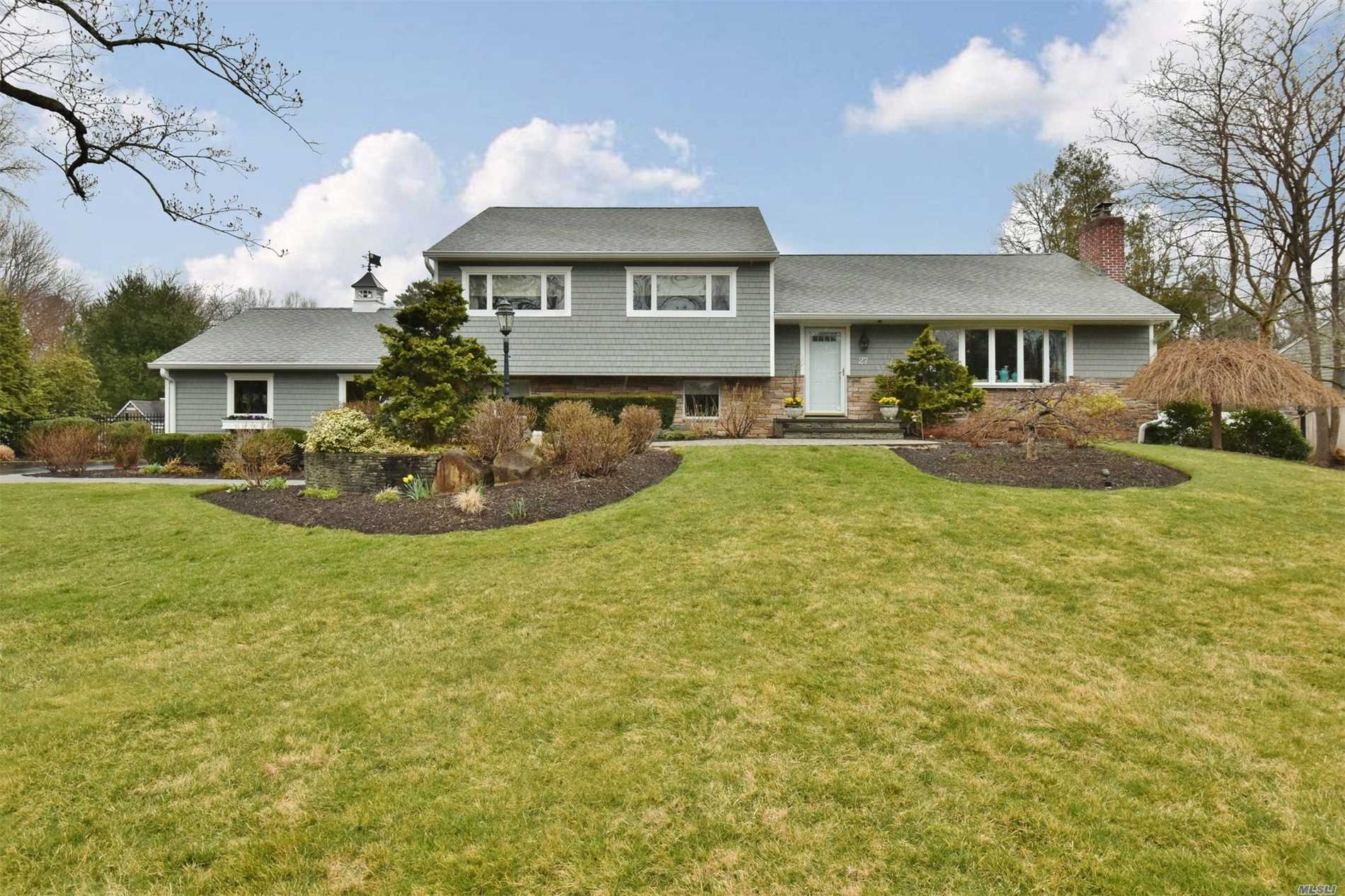 Entertainer's Dream Home located in Harborfields SD. Beautifully landscaped flat one acre property w/heated inground pool, patio and pergola. Sliders off kitchen to deck w/gas barbecue attached to home. 2 Gas Fireplaces, 3 Bedrooms, 3 Full Baths, Must See!