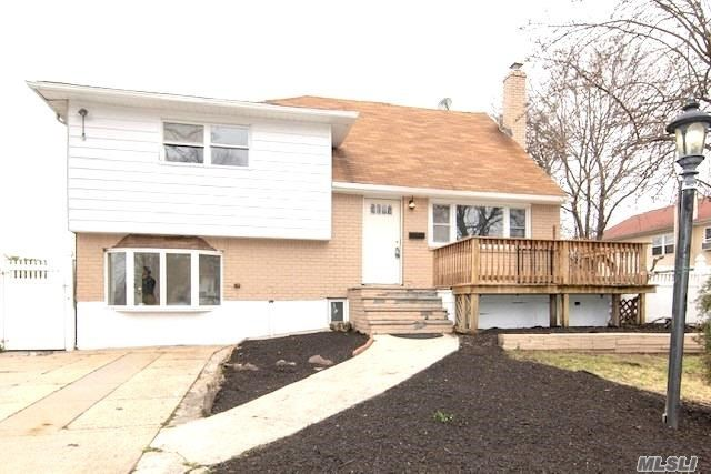 Large split level 5 bedrooms 3 full baths, perfect for large families, 4 flights of stairs leading to 5-floor levels with many updates. Move in ready!