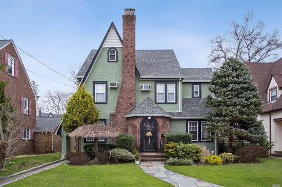 Beautiful Tudor Located In The Heart Of Cathedral Gardens. Gorgeous Brand New Eat In Kitchen. Formal Living Room With Fireplace, Dining Room. Master Bedroom w/Master Bathroom and One And A Half Additional Baths. Large Half Up Attic, Full Basement, One Car Garage.