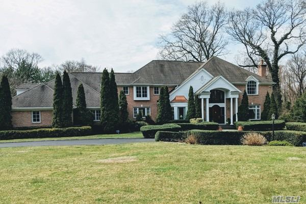 . Grand Brick Colonial set on a Brookville cul-de-sac, 2 Acres... Huge Marble entrance leads to a newly redone foyer and staircase, Great rm with coiffured ceilings, fireplace. office, sunken lvr room, Cherry wood & Granite Kitchenw/radiant, Stainless Steel Appliances, Floating Buffet or Bar. New Trex decking, Master suite with den and terrace.4-5 large additional bdrms..3000 sq ft newly finished basement with bdrm, bath, cedar closet, tv room and 2nd staircase... new deck with pool... a must see.