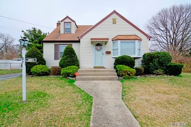 Charming Cape style on a nice quiet st, featuring 4 bdrms, 2 baths, 1 zone CAC, IGS, new deck, fenced in yard, new kitchen appls, Hdwd flr, partially finished basement w/wood burning stove,  1 car garage, Low taxes.