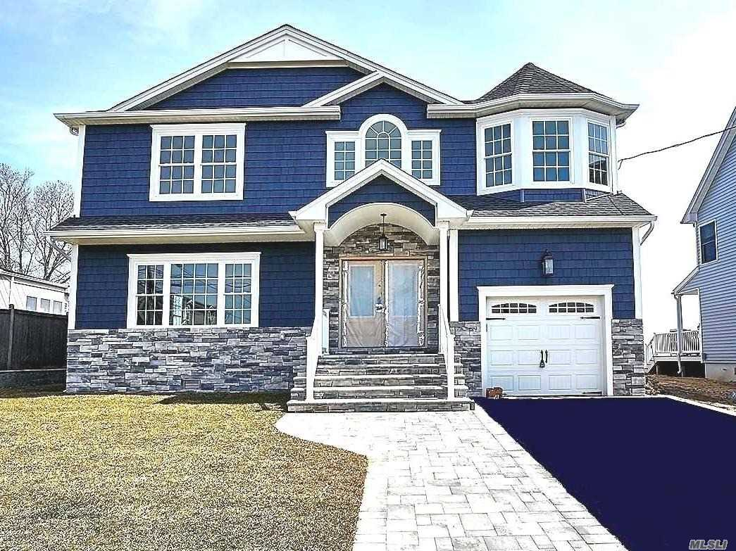 Brand New Gorgeous Waterfront Colonial just Built (Completed--MOVE RIGHT IN FOR SUMMER!) On 9000 Sq Ft Waterfront Lot (60x150) On The Bay, Within A Protected Cove. Comes W/Your Own Boat Pier (To-Be-Fixed-Up), Room For Patio/Pool/etc, & Private Beach In Bkyard! Truly 1-Of-A-Kind Water/Beach-Front home W/Panoramic Views Of The Great South Bay From Bkyard/Mstr Balc/Etc! Expertly Designed & Finished W/The Utmost Quality Of Materials & Craftsmanship.
