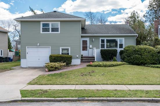 *Seller Has Applied For Grievance* Come See This Beautiful Spilt In Barnum Woods! 3 Br, 2.5 Bth Boasting Extended Eik With Gas Cooking,  Fdr & Lr With Gleaming HW Floors, Spacious Family Room, Finished Basement, Windows/Siding New 2017, Updated Boiler, Elec, New HW Heater, Backyard for Entertaining!
