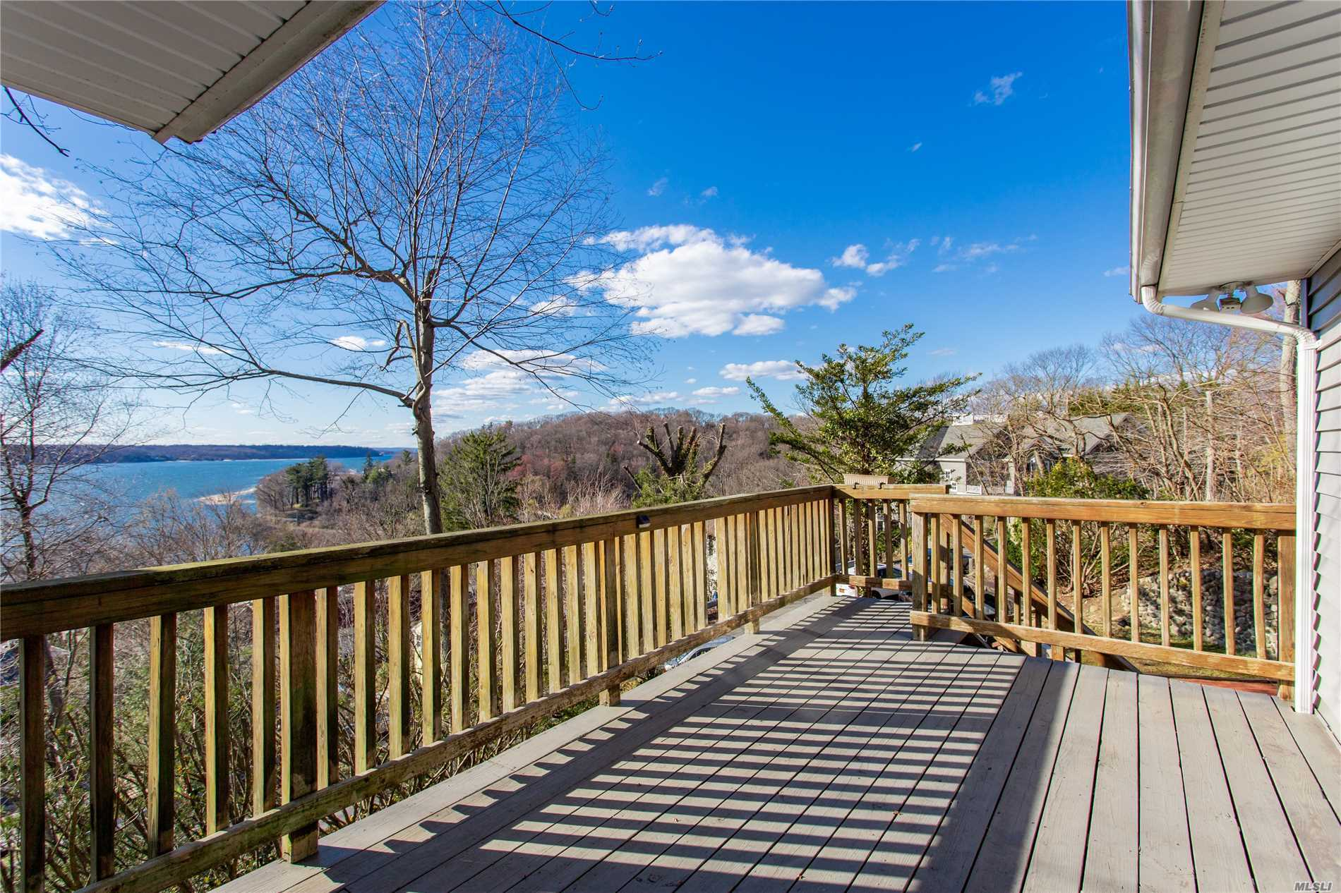 Seaside authentic mid-century cottage enjoys YEAR ROUND WESTERN WATERVIEWS, nightly sunsets, cathedral ceiling in LR w fireplace, hardwood floors and close to town, beach, railroad. Eagle Dock Beach and Cold Spring Harbor schools nearby.