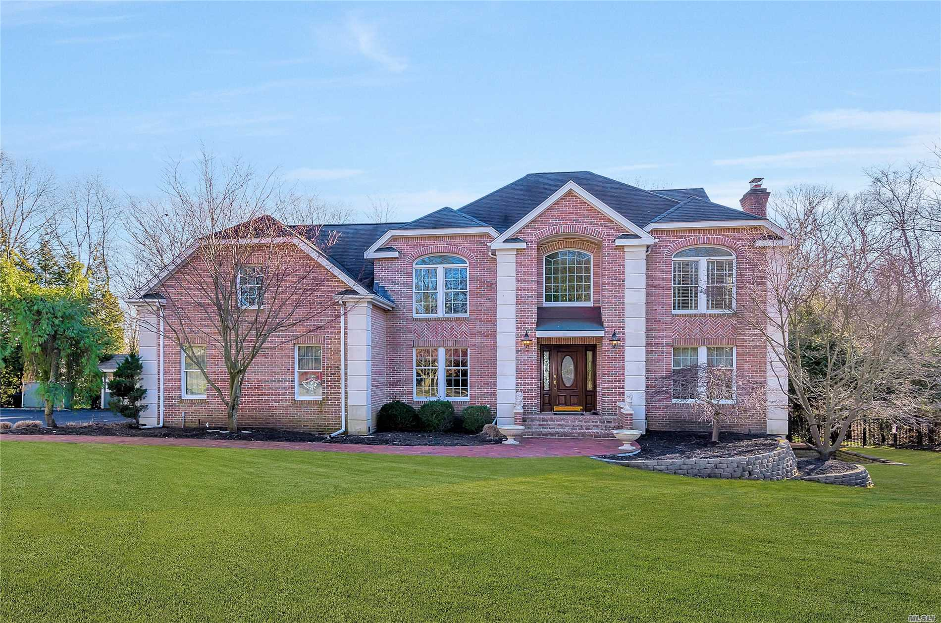 Stately Colonial Features: Spacious Floor Plan, Entry Foyer, Formal Living Room/Fireplace, Expanded Formal Dining Room, Eat In Kitchen, Beautiful Windows, Family Room/Fireplace and Vaulted Ceiling, Den, Laundry Room, Hard Wood Floors Throughout, 4 Bedrooms, 2 1/2 Baths, Dual Staircase, 500 Amp Service, Basement Features A Legal 1 Bedroom Apartment with EIK, Den, Bath, Laundry and Storage, Backyard Privacy, Ing Heated Gunite Pool/Waterfall, Mahogany Deck/Hot Tub, the list goes on......