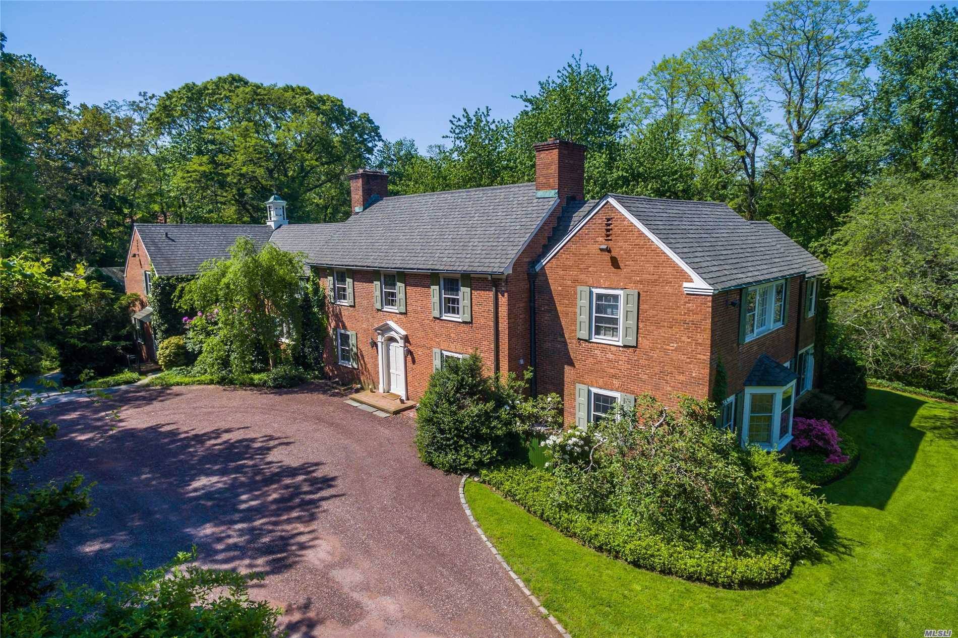 Have you always dreamed of living in a beautiful Brick Colonial surrounded by lush lawns & beautiful trees with total privacy? Your dreams have been realized! Located in the heart of the Incorporated Village of Mill Neck & in Locust Valley Schools. Its International Baccalaureate Program is recognized worldwide for high academic standards.Main House has large inviting rooms with attached 3 car garage. Multiple fireplaces.There is separate 3 car garage which has a large loft with high ceilings.