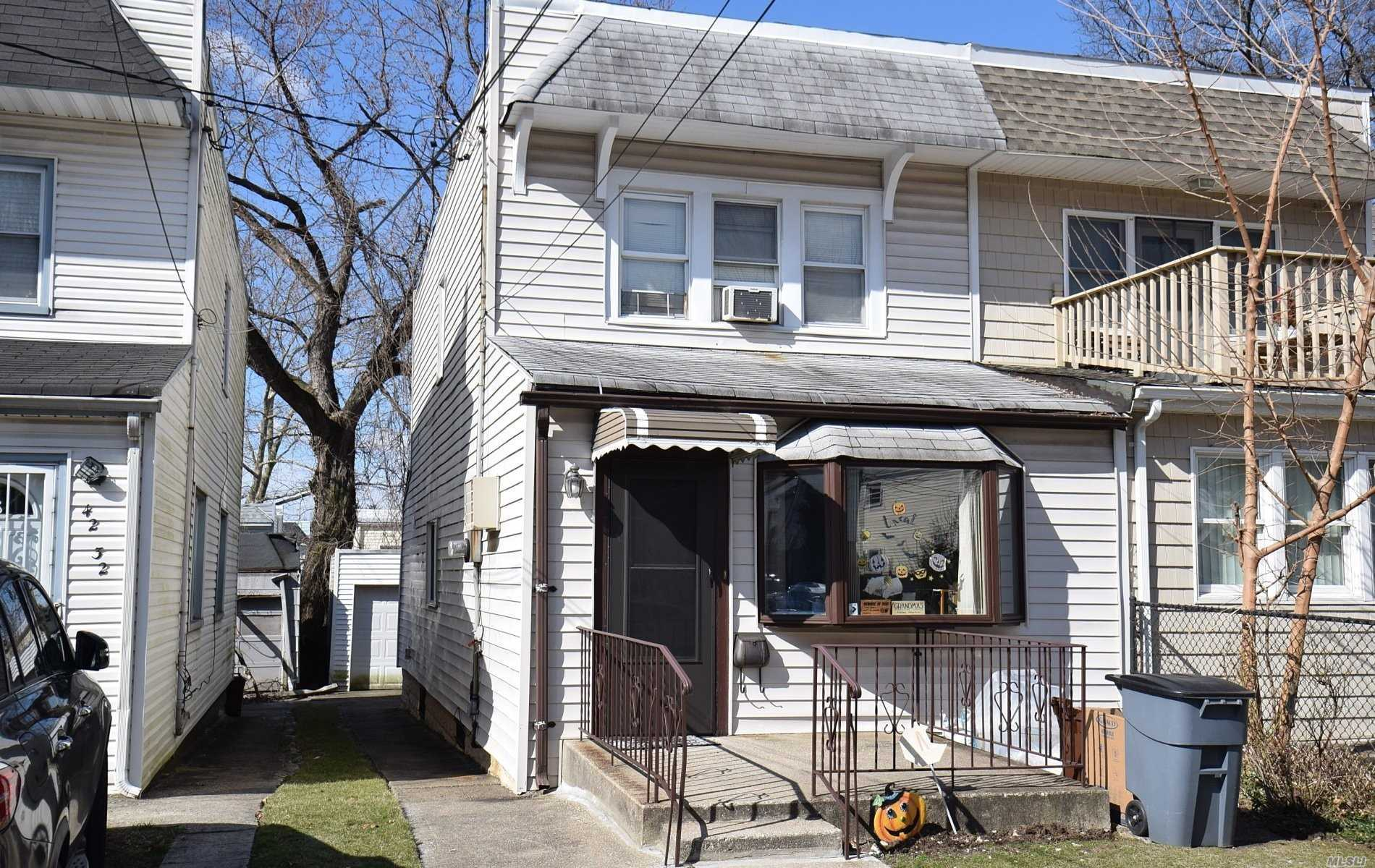 Location, Location! Perfect semi close to schools, transportation and shopping. Wood floors,  newer kitchen and half bath.