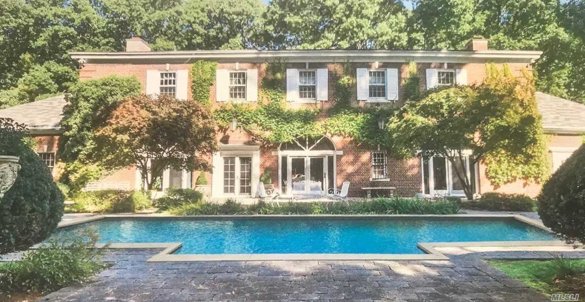 Beautifully maintained and renovated (2000) carriage house on 2 wooded acres, this 6728 sq ft home has meticulous detail, moldings, 14 ft ceilings, arches doorways, expansive Eik with gas cooking, gourmet formal dining w/ fpl, radiant heat, old world charm with modern amenities, low taxes...