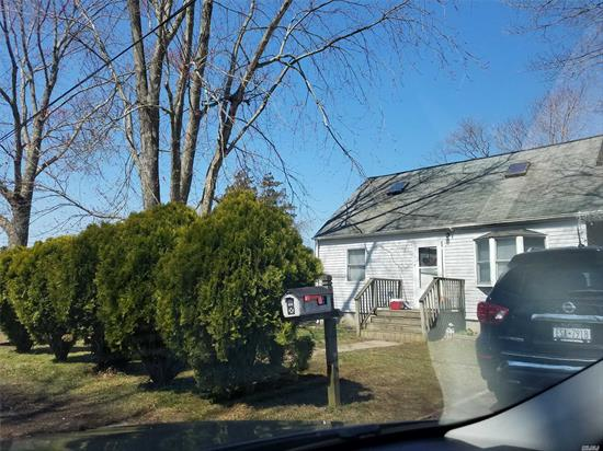 3 Bedroom Cape on a nice property located in Mastic Estates
