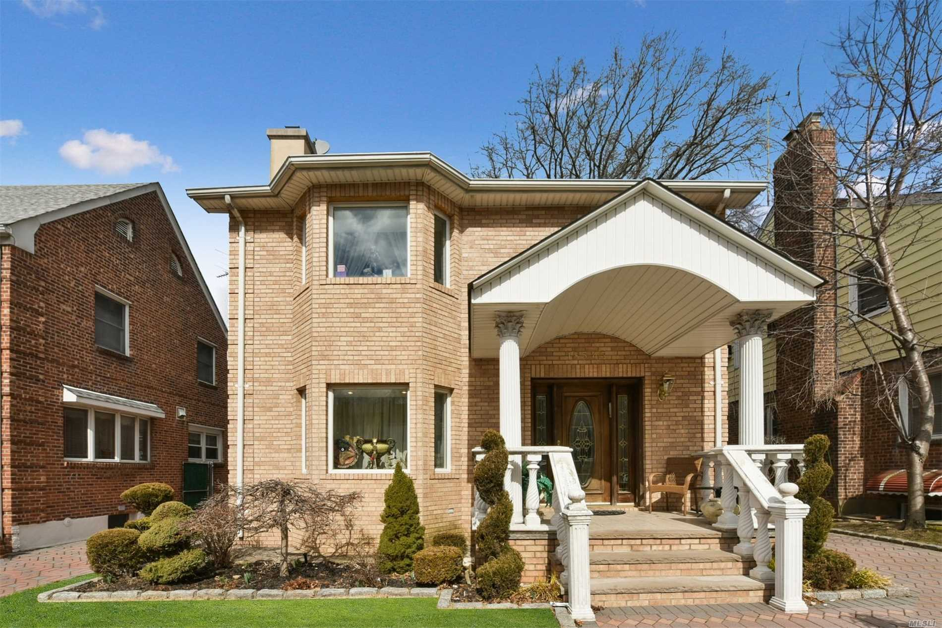 Renovated House in the heart of Jamaica Estates, the house features foyer, living room w/wood burning fireplace, large Family and Dining Room, Spacious Granite kitchen with separate breakfast area, 3.5-Bathrooms, Master Bedroom with Master bath plus additional 4-Family size bedrooms. The house also has a full stand up attic with 2-spacious rooms and closets, full finished basement with bath and a separate entrance. Entertain all your guests in a large backyard that has 1-Car garage and fish pond