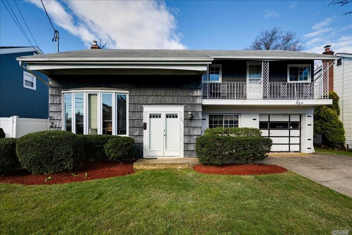 $5, 000 Tax credit given to buyer at closing to offset the delayed property tax reduction in due in 2021 grievance.  Spacious home on large property on quiet street in prestigious SD#14. 4 large bedrooms on 1 level, beautiful rear deck with room for playground. New windows, new electric, new gas boiler. Close to Woodmere and Hewlett shopping and LIRR. This awesome home won't last long.