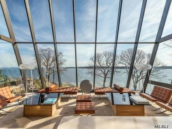 Exceptional Waterfront Contemporary Designed By The Renowned And Highly Acclaimed Architect Norman Jaffe. The Stone, Wood, Steel And Glass Elements are United to Create This Glorious Piece Of Art With Unlimited Views Of The Long Island Sound. Extraordinary Upgrades With Every Attention To Detail And Quality.Brilliant Radiating Pool Surrounding Outdoor Entertaining Spaces.
