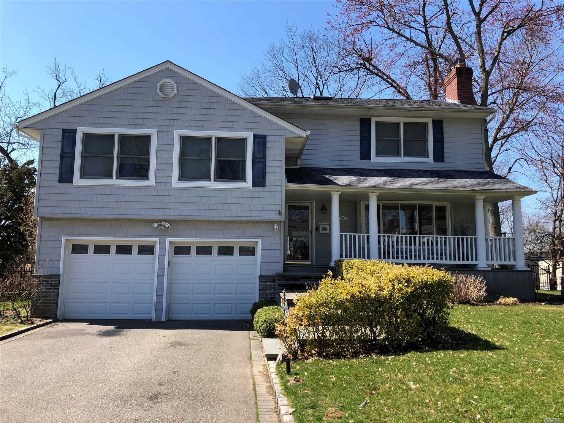 Large expanded split on over one quarter acre. Rocking chair front porch, Living room w/.stone fpl, DR, EIK, den plus playroom basement with laundry.Upper level offers huge Master suite with bath, walk in closet and deck. Attached 2 car garage, CAC, Gas heat. Beautifully landscaped private property. Short distance to town, train and schools.