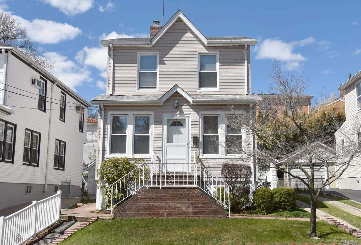 Sun drenched 3 bedroom, 1 bath colonial featuring parquet flooring. Wonderful sunlight fills the large living room and dining room. Eat in kitchen with the convenience of a washer/dryer. 3 bedrooms and full bath, finished basement and 2 car garage. Convenient to LIRR, mass transit and houses of worship. District 26 schools.