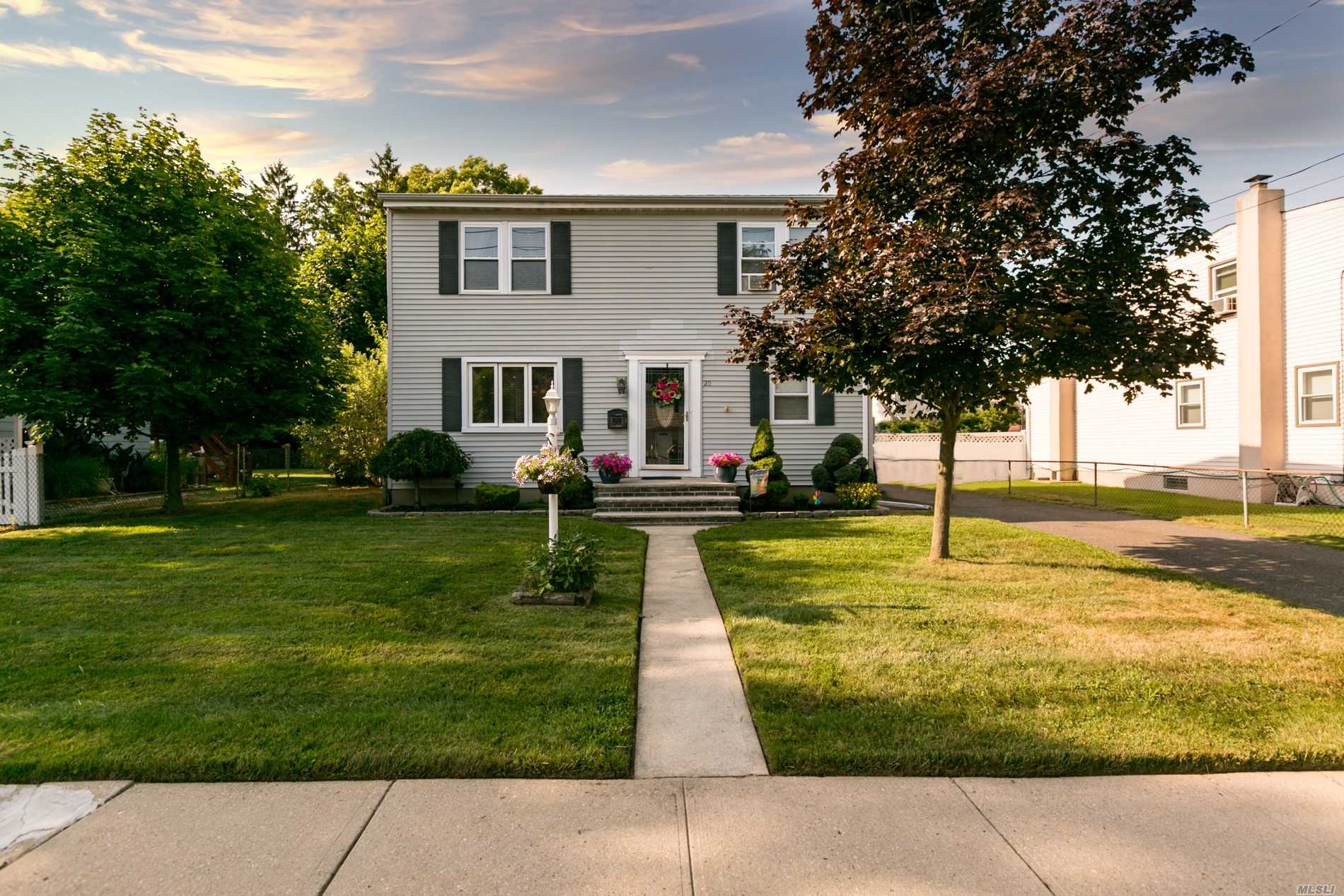 Beautiful Updated Colonial Featuring A Large EIK, 4 Br's, 2 Full Bath's, Large Finished Basement, Detached Oversized 1.5 Car Garage, Expansive Backyard That's Perfect For Entertaining.