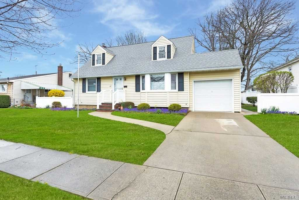 Sun-filled expended cape . Midblock location. Hard wood floors, Newer siding insulation , waterproof basement, Hard wood floors ...Pictures coming soon....