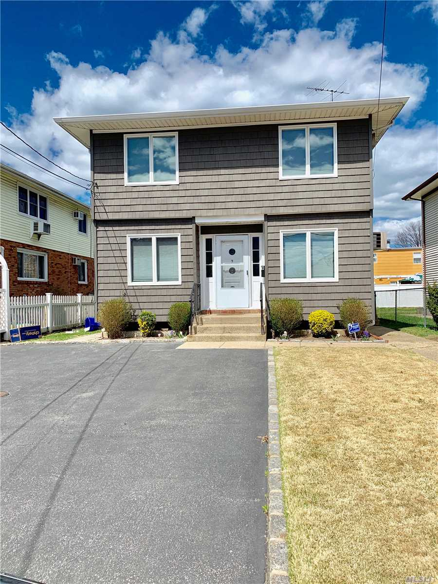 Renovated 2 bedroom 1 bath first floor apt. New Kitchen & New Bath, Sunfilled LR, Wood Floors, Shared use of backyard. Washer & Dryer & Storage in basement. Offstreet parking for 2 cars. Pets with Xtra Security