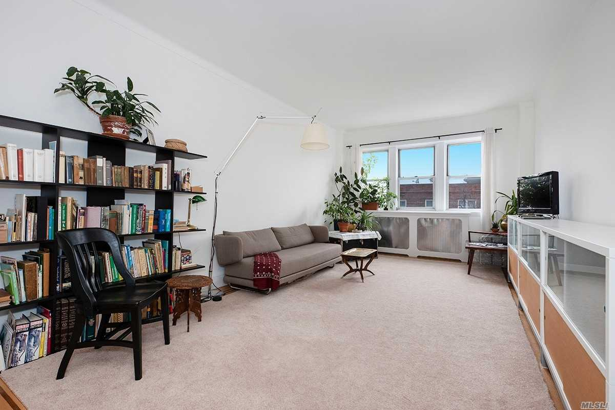 Warning: You Will Fall in Love!!!  Elegantly Renovated Extra-Large Sun-lit, Top-Floor Pre-War 1BR W/High/Coved Ceilings, Hardwood Floors W/Mahogany Inlaid Borders, & Oversized Closets. LR, FDR, Eat-In Kitchen, W/SS Appliances, White European-Tiled Bath W/Separate Soaking Tub and Shower.  Art Deco Era Gem Griswold Hall Is Pet Friendly with Private Dog-Run, Has A Large Children's Playroom And Serene Gardens. Low Maintenance is Icing on a Superb Cake!!