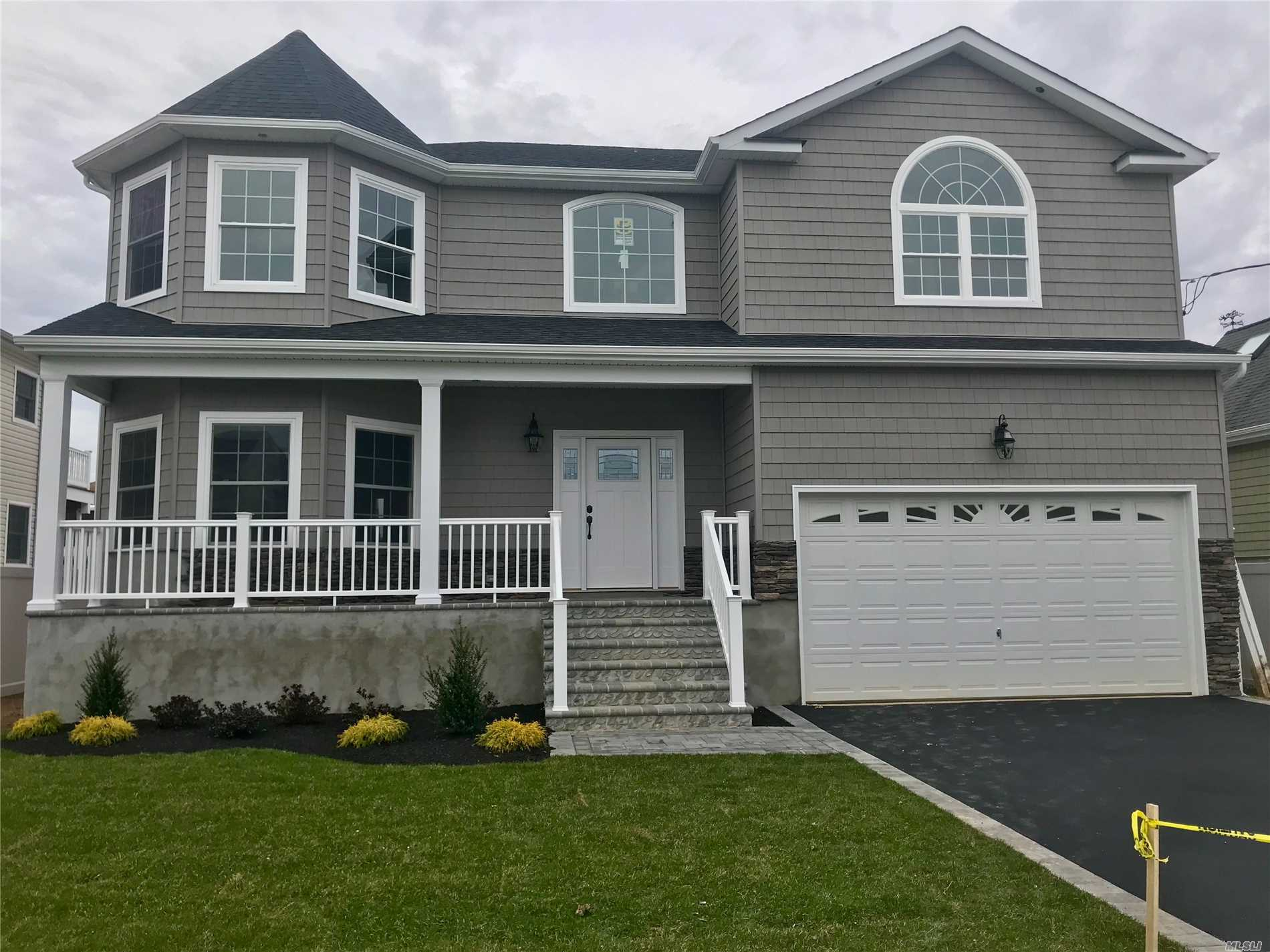 Stunning New Colonial Waterfront Construction.Seconds To Open Bay.Large Open Concept.9Ft Ceilings, Custom Designed Eik W/7Ft Granite Island, Sliders To Backyard W/New Bulkhead, Family Room W/Gas Fireplace, Formal L/R, D/R 1/2 Bath-2nd Fl Features: Designer M/B/Suite W/Tray Ceilings, Slider To Balcony W/Water Views, H/H Wic, 3 Lge Addt B/R & Full Bath W/Cathedral Ceiling & Skylight, W/D 2nd Fl, Custom Crown Molding, Cac, Hvac, Igs, Landscape, Pavers, Built High Evevation To Fema *Move Right Into Your Dream Home*