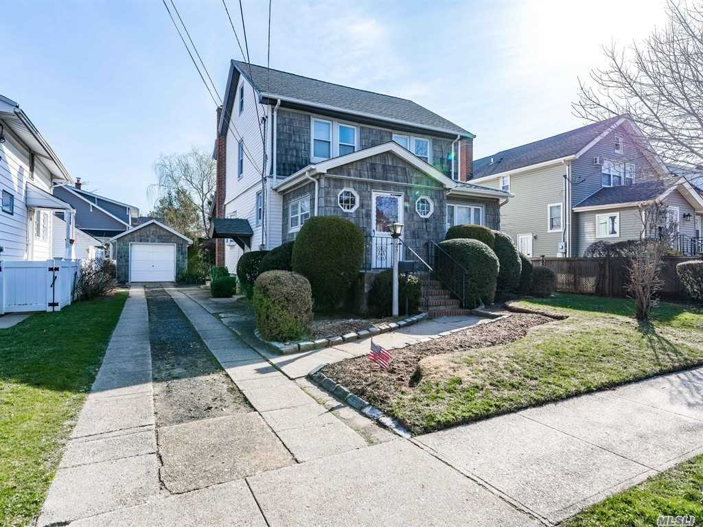 Lynbrook South Colonial. 4 Bedrooms 2 Baths Including Rear 1st Floor Master Suite Extension With Basement. Oversized Livingroom. Oak Floors. Unfinished Basement & Walk Up Attic. Newer architectural Roof & Windows. Marion Street Elementary, South Middle & Lynbrook High School.