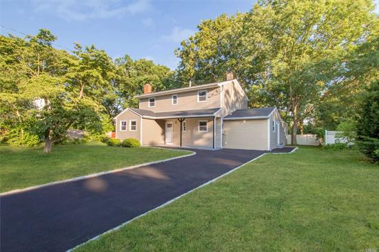 Stunning Large Colonial Completely Renovated & Remolded From top to bottom. Do not miss out on this Wonderful 4/5 Bedroom 3.5 Bath Home With a Large Flowing Design with NEW Everything Custom Kitchen & Baths Formal Dining Room And A Beautiful Living space With Fireplace, Recessed Lights through out Set up for Mother Daughter with proper permits large yard & patio for entertaining plenty of space perfect Location Close to shopping Restaurants, Gutted to the studs Will not last !!