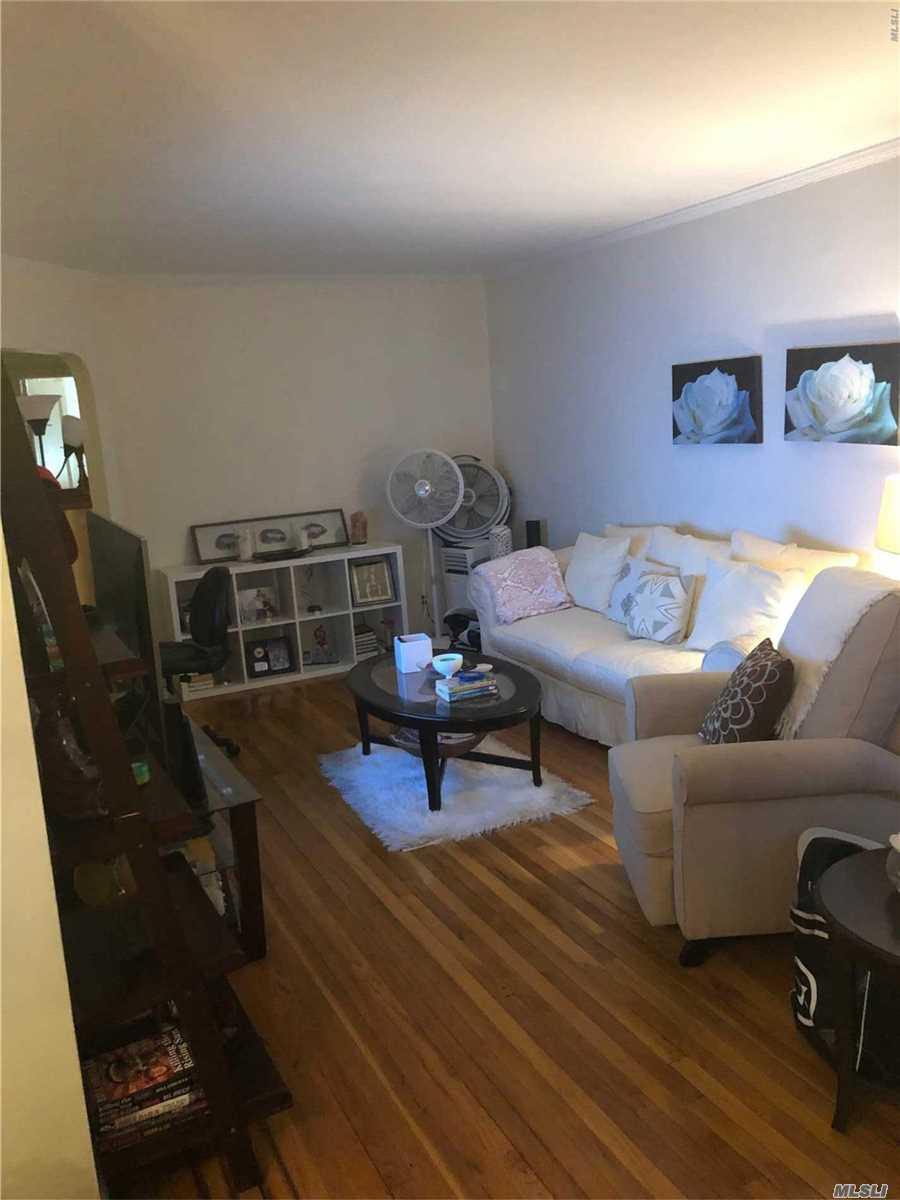 2 Bedroom , 1 Bath one a second floor apartment , Updated Kitchen and bathroom, hard wood floors thru-out , small balcony excellent location for Transportation and Shopping in Whitestone.