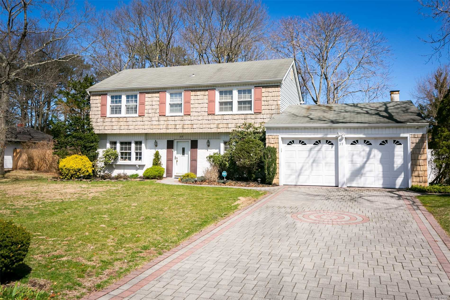 Immaculate 4 BR, 2.5 Bath Colonial Located in Comsewogue School District Featuring Updates Throughout The House, Large Over-Sized Den w/New Gas Fireplace, FDR, Recently Renovated EIK, Impeccably Maintained House w/Too Many Updates To List - Large IGP w/Large Paver Patio - Taxes w/ STAR $ 9319.02