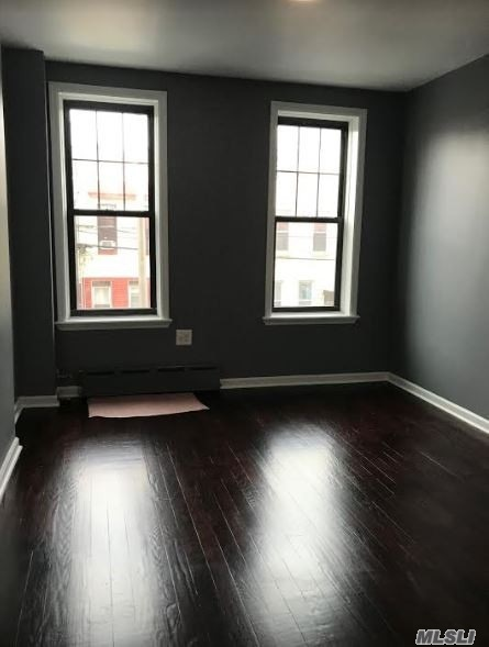 Lovely Renovated Apartment For Rent In Ridgewood Features Living Room/ Dining Room Combo, Eat In Kitchen, 2 Bedrooms Railroad Style & 1 Full New Bathroom. Heat And Water Is Included. Hardwood Flooring Throughout. Close To Shops And Transportation. Wont Last !!!