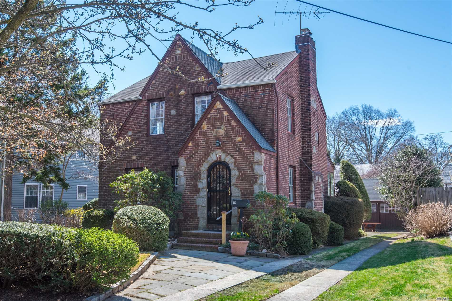 Add Your Special Touch To This Classic Brick Tudor In Desirable Estate Section With A Beautiful Secluded Back Yard.Formal Living Room With Brick Fireplace. Formal Dining Room, Eat In Kitchen 3 Bedrooms 1.5 Bath.Overlooking Lovely Gardens And A Detached Garage.