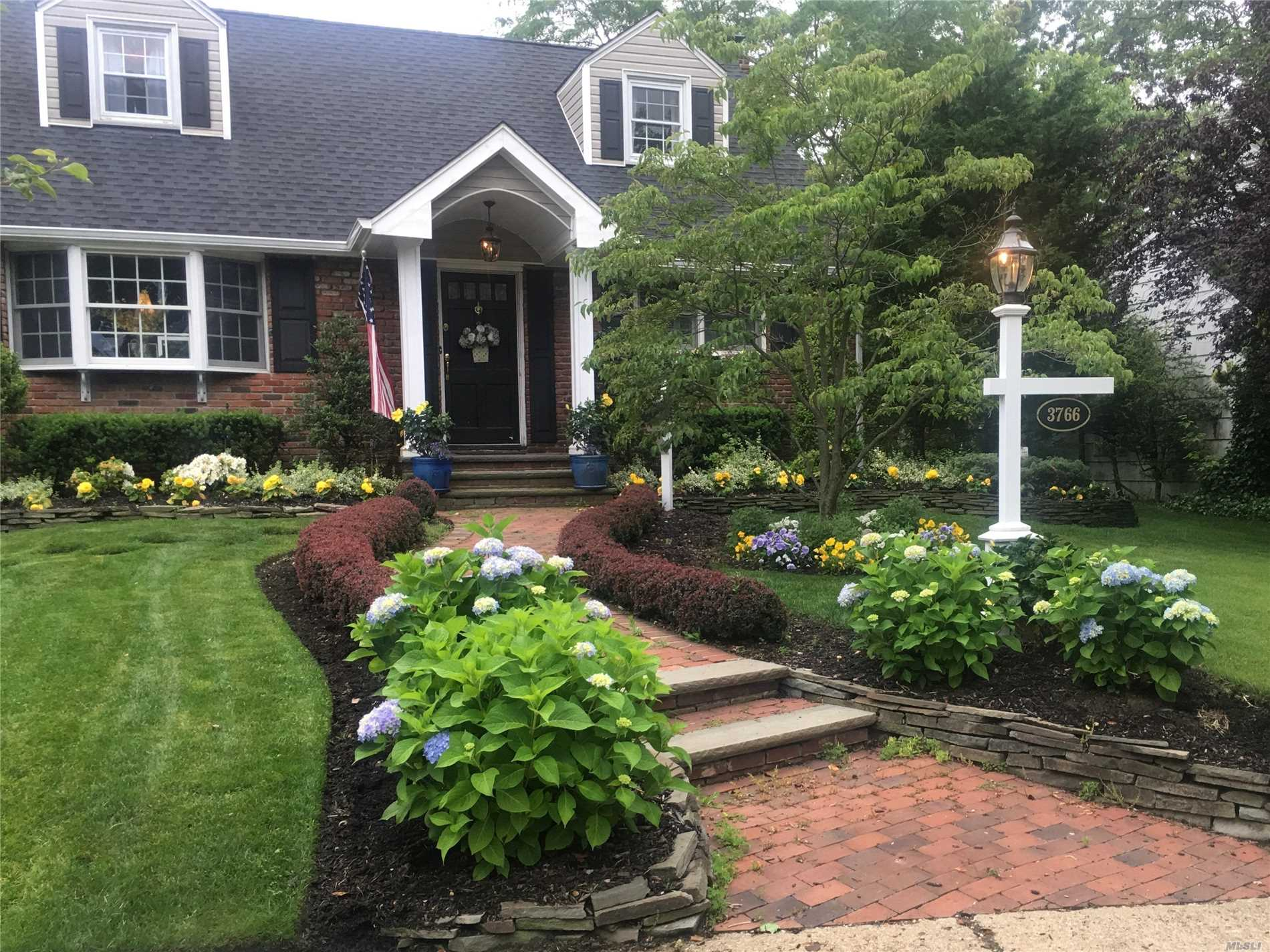 Welcome to this charming 4 bedroom home that offers a great room with wood burning fireplace & brazilian hardwood floors! This home features updated gourmet kitchen w/granite counters & SS appliances, new carrara marble bath, second floor new bath, andersen windows, gas boiler, brand new architectural roof, 150 Amp service, garage attic w/pull down stairs, deck off great room to lovely yard with 6 zone sprinkler system! All this & more in Seaford Manor with Seaford schools!