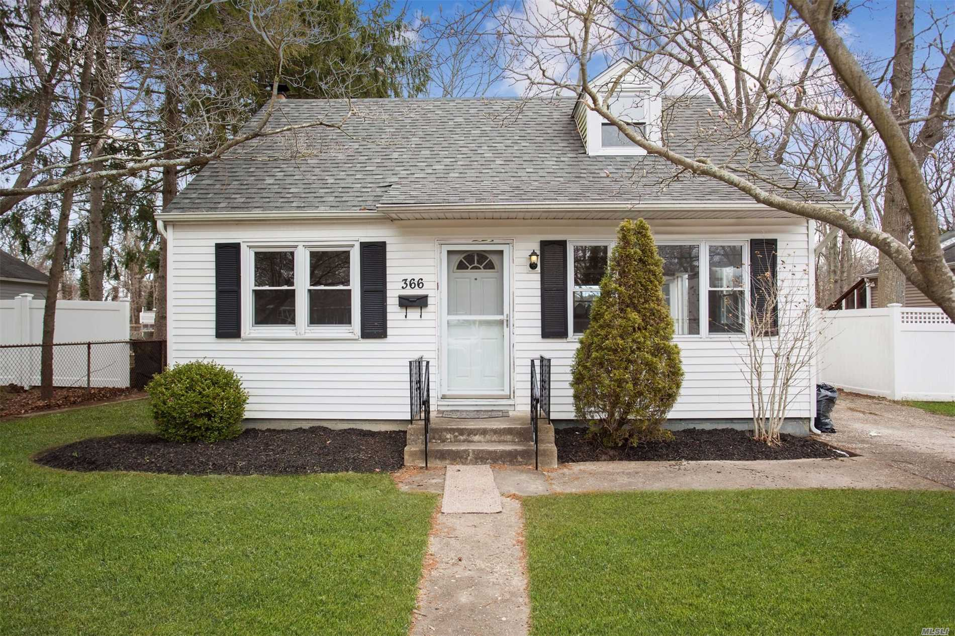 Come see this lovely 4 Bedroom 1 Bath Cape all ready to move in - Updated Kitchen w/New Stainless Steel Appliances, Freshly painted, New Carpet & Flooring, Full Unfinished Basement with Outside Entrance, Large Property, Longwood Schools and Super Low Taxes - $5594.29 - After Star Rebate $4378.29
