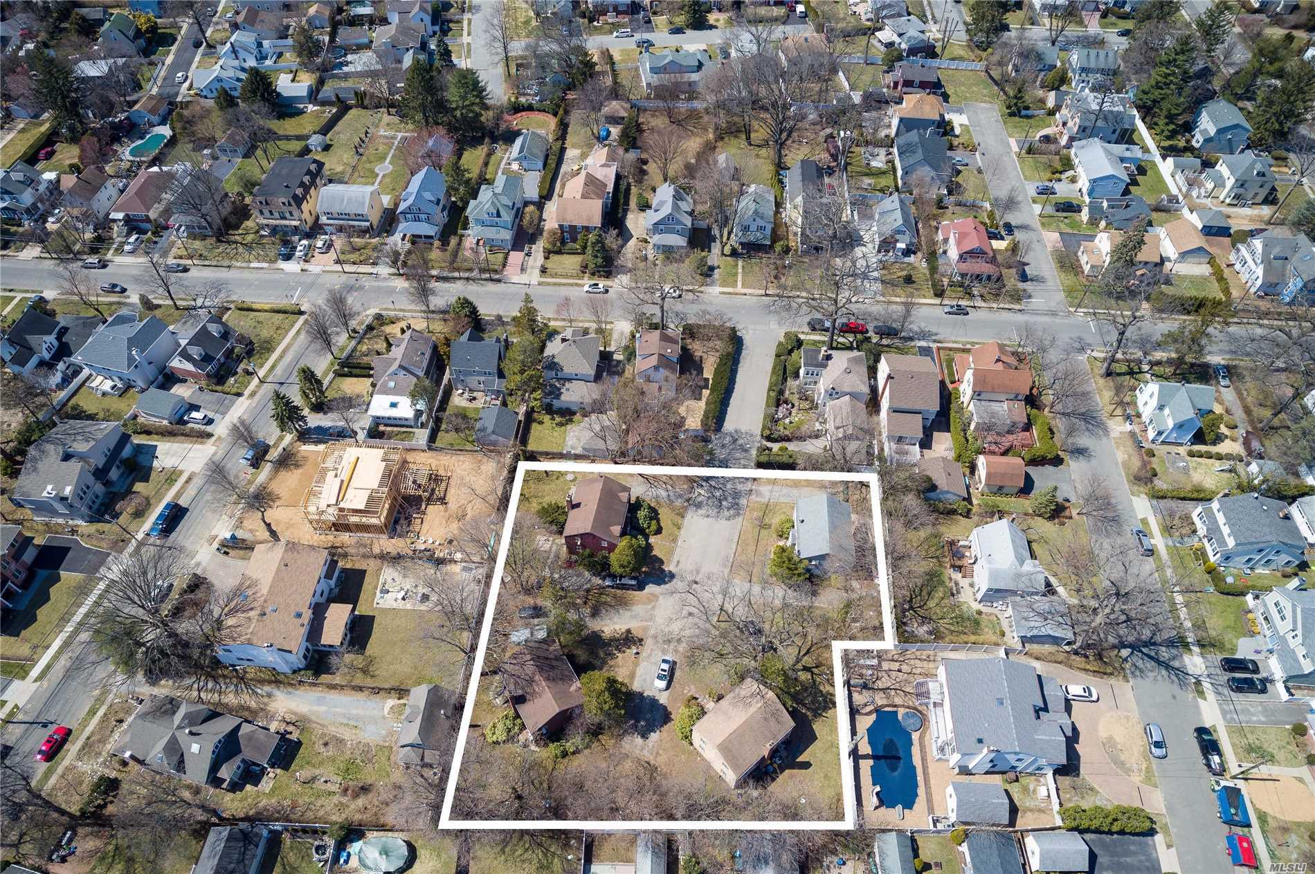 4 Two family homes comprising an entire cul de sac. Each home has one 2 bedroom and one 3 bedroom duplex apartment plus basement. Close proximity to LIRR and Roslyn Schools.