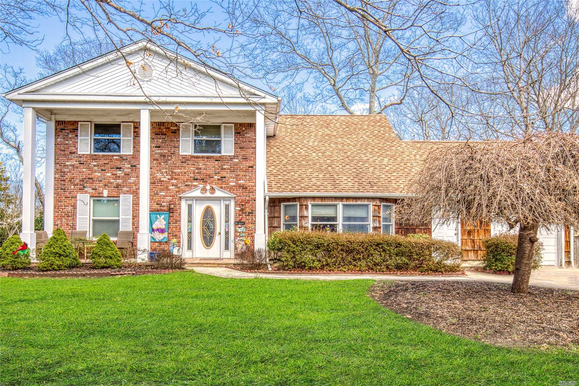 Lovely & Spacious 4 Bedroom, 2.5 Colonial with EIK w/Oak Cabinets, Stainless Steel Appliances, & Ceramic Tile Floors, Updated Baths, Hardwood Floors, Full Brick Wall Fireplace, Some Andersen Windows, 200 Amp Electric, New Hot Water Heater, Newer Above Ground Oil Tank, 2 Attics, New Pillars, Newer: Roof, Siding, Leaders, & Gutters, Large .41/Acre Corner Property with New Deck, Crab Orchard Porch, Shed, IGS, Fenced Yard, & More! Won't Last! A Must See!