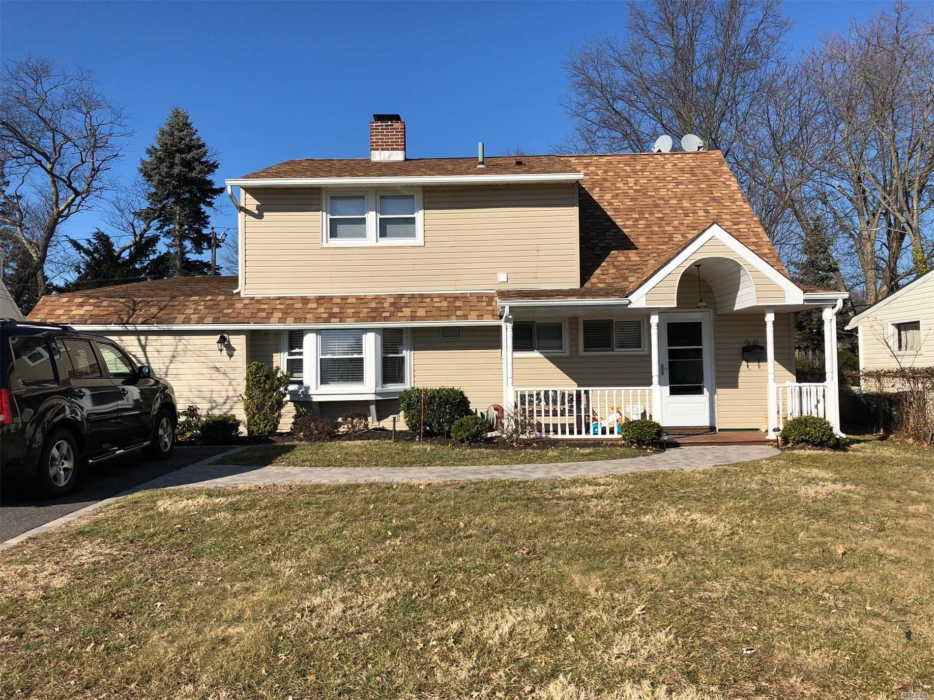 Spacious Updated Home in Salisbury, East Meadow School District. Updated EIK w/ Granite Counter Tops, SS Appliances, Updated Bathroom, 4 BR's, MBR on First Floor Total of 2.5 Baths, FDR, LR/FamRm. Backyard has Koi Pond/Jacuzzi. Potential Mother /Daughter w/ Proper Permits. MUST SEE!